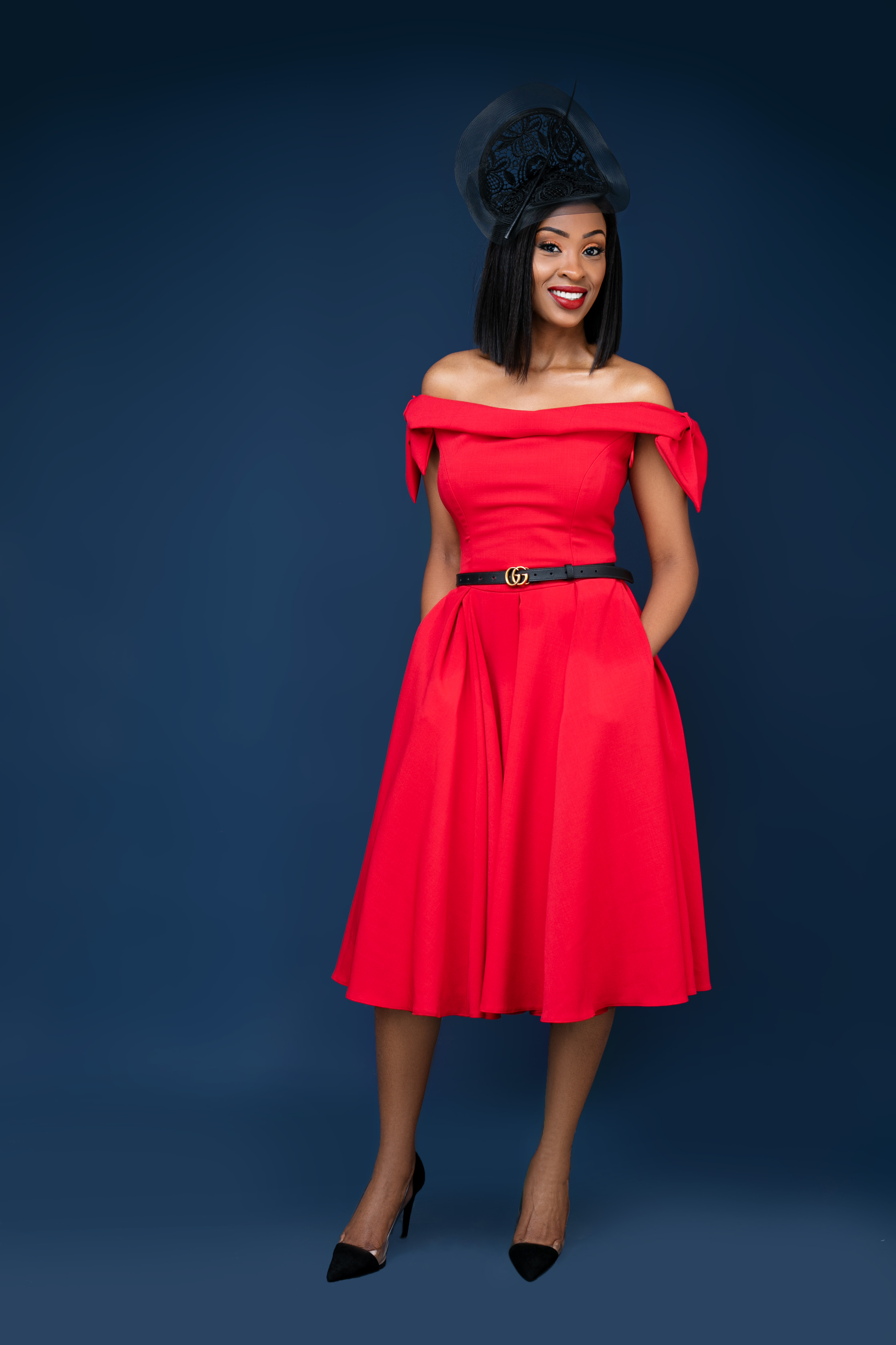 woman in red off shoulder dress